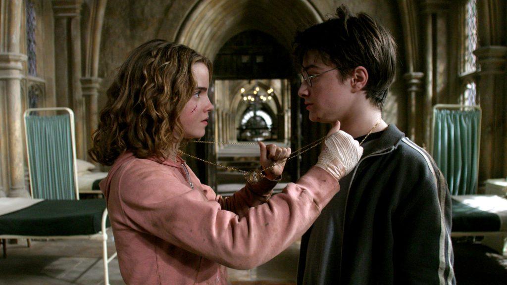 Harry Potter et Hermione Granger avec le retourneur de temps dans Harry Potter et le prisonnier d'Azkaban par Alfonso Cuaron