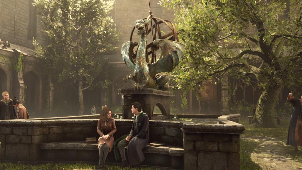Deux élèves de Poudlard, une fille et un garçon, discutent, assis sur un banc dans le jeu vidéo Harry Potter : Hogwarts Legacy